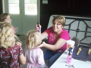 Submitted Hair sylist Julie Kinert creates a new look for one princess Saturday at the Lovington Church of God.