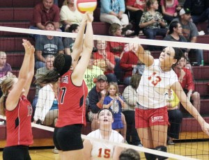 Photo by Keith Stewart The Lancers' Jessica Davis puts a kill on during Monday night's matchup with Sullivan. Davis had plenty of big hits in the third set to give her team the momentum it needed to ensure the win and its continued undefeated streak, which stands at 9-0.