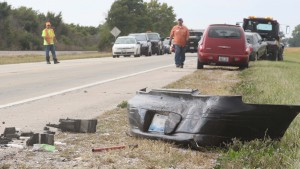 Photo by Keith Stewart The bumper off of Debra Yowell's Pontiac sits to the side of Route 121 Tuesday afternoon.