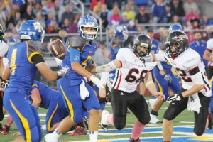 Maroa-Forsyth quarterback Jack Hockaday pitches the ball to running back Chad Howell Friday.