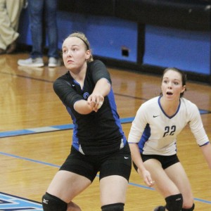 Photo by Keith Stewart OV's Amy Orris prepares to receive a volley as libero Shelby Dash provides support.