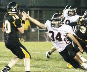 Photo by Keith Stewart SOV senior linebacker Kainan Bushert goes to strip the ball from Tuscola quarterback Zach Bates Friday night. Bushert's defensive showing included one fumble recovery.