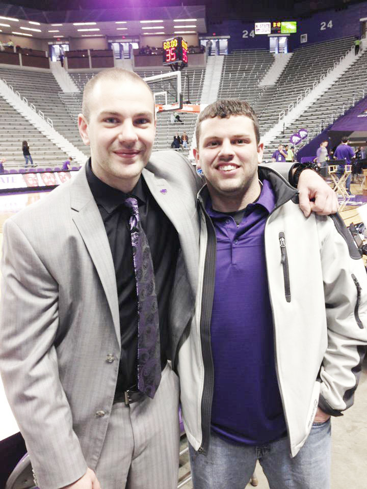 Photo Submitted Dustin Yoder (left) is seen here at Kansas State University with close friend Michael Corum. Yoder was recently promoted by Kansas State Men's Head Basketball Coach Bruce Weber to video coordinator.