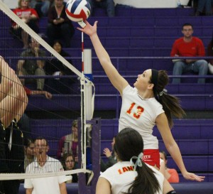 Photo by Darian Hays Junior Jessica Davis tips the ball over Tuesday night against Atwood-Hammond.