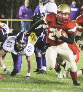Photo by Keith Stewart Tyler Schuring takes off Friday night. This was a common sight last week when ALAH took on Arcola in Atwood, as Schuring ran for three touchdowns. The junior quarterback also threw for one touchdown and returned an interception for another in his team's 42-14 victory.