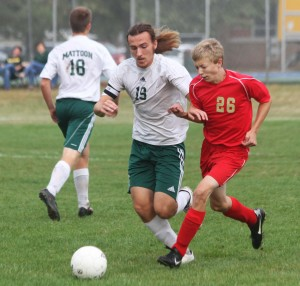 Photo by Keith Stewart Mattoon's  Chase Harvey battles ALAH's Brad Miller for the ball.