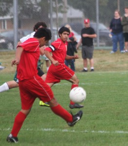 Photo by Keith Stewart ALAH's Javi Briseno crosses the ball to teammate Omar Martinez during their game against Mattoon a week ago Saturday.
