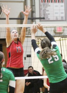 Photo by Keith Stewart Sullivan's Brittin Boyer goes up for the block against Meridian's Maggie Comerford, who was a force on the front line last Thursday as she helped lead her team to a 25-12, 25-17 win over the Lady Red.