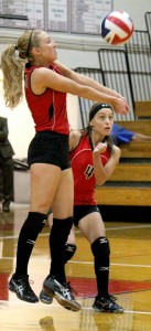 Photo by RR Best Maggie Plank provides a dig during the Lady Red's game against Maroa-Forsyth.
