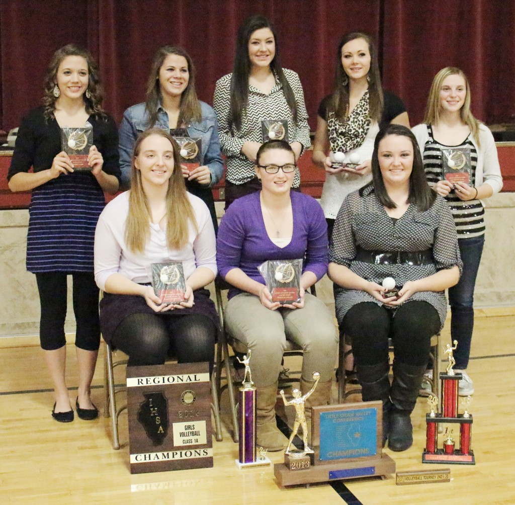 Photo by Darian Hays AL Volleyball Banquet Awards The Arthur-Lovington volleyball team held their awards banquet Tuesday, November 19. Pictured are this year's award recipients. Front row, L-R: Brooke Tabb, best serve percentage (94), best attack percentage (90), most digs (281), and hustle award; Kalli Martin, team spirit award; Emily Seegmiller, most aces (55), and most valuable player; Jessica Davis, best attack percentage (90), and best block percentage (19); Logan Kauffman, most improved. Back row, L-R: Karly Goodman, best ace percentage (21), highest kill percentage (40) and most kills (206), most blocks (27), best block percentage (19), serve-reception percentage (90), sportsmanship and coaches' award; Sherelle Coller, best setting percentage (98), most assists (563), assist percentage (33), variety captain, and coaches' award; Hannah Schrock, best block percentage (19). The team also celebrated three All-LOVC selections. First team: Karly Goodman and Emily Seegmiller; second team: Sherelle Coller.