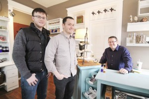 Photo by Keith Stewart Tyler Mosier, Timmy Valentine, and John Stephens (L-R) recently opened the Astoria Company Store, which features homemade soy candles, lotions, soaps, and more. Astoria is located on the first floor of the Harrison Street Inn, in Sullivan.