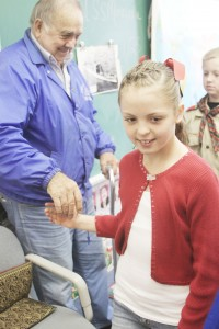 Photo by Keith Stewart SES fifth grader Zoey Walton shakes Francis Drummond Jr.'s hand after he spoke to her class about his experiences in the military and life.