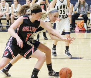 Photo by Keith Stewart Sulilvan's Brittin Boyer battles Anna Hartke for the ball Monday night in Teutopolis. Boyer led a stingy offensive night for Sullivan with just 10 points, while the Wooden Shoes easily outdid the Lady Red 67-24.