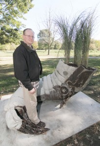 "Photo by Keith Stewart Cary Netherton, a Sullivan native and now Minneapolis based sculptor, stands with his newly reassembled creation ""Fallow"", which he donated to the city of Sullivan and that now resides in Tabor Park."