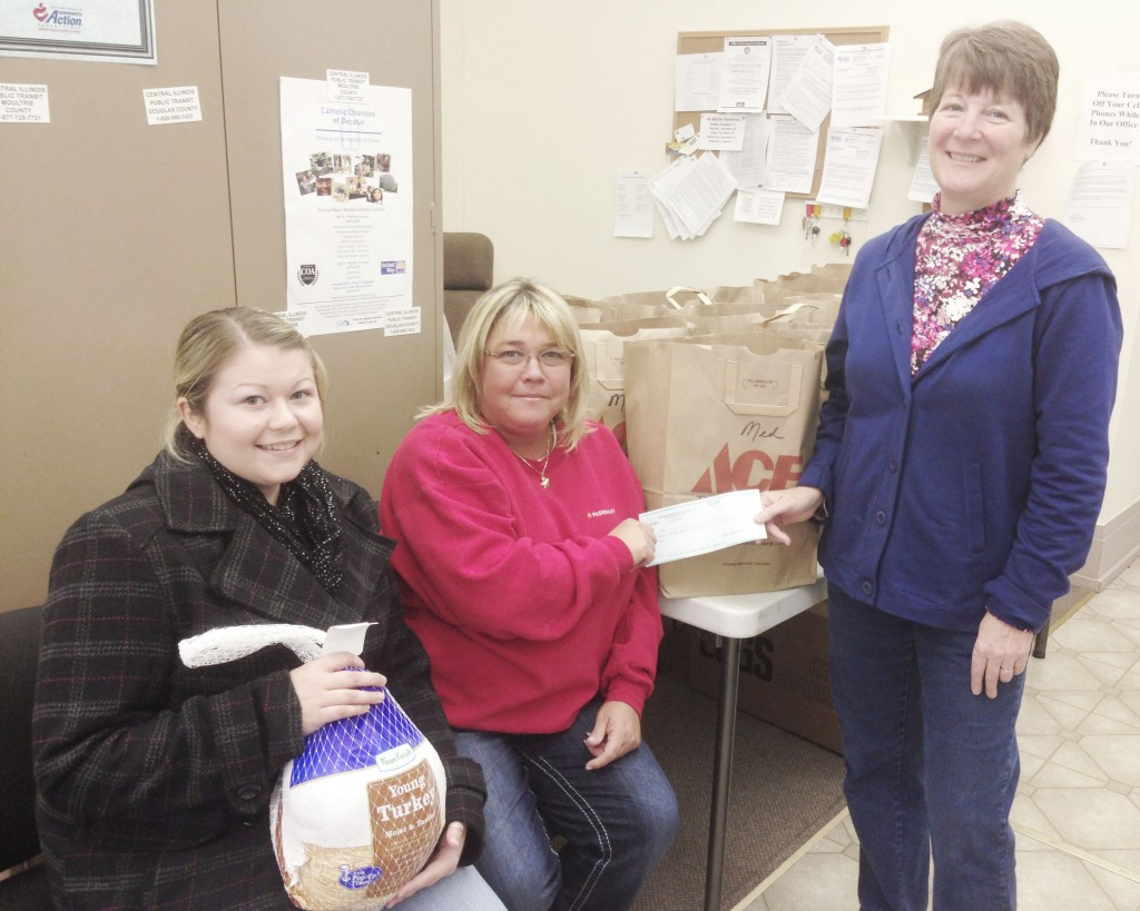Photo by Keith Stewart Owner and operator of Sullivan McDonald's Angie Matlock (middle) recently donated a $500 check to the Moultrie County Food Pantry, which in turn used the money to purchase turkeys for the Thanksgiving holiday. Pictured to her left is Lindsay Schmohe, a volunteer with the Moms On a Mission in Sullivan group, and to her right is the food pantry director Barbara Waymire.