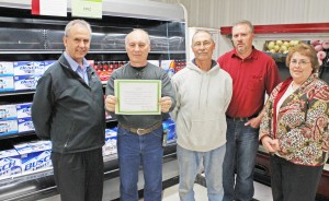 Photo by RR Best Pictured from left to right are: Bethany Foods owner Atta Abbed, Bethany mayor Bill Ashley, village trustees Dick Roe and Craig Wigness and former Bethany mayor Barb Meador.
