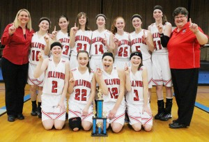 Photo by RR Best Pictured is the Sullivan girls' varsity basketball team with their first place Okaw Valley Tournament trophy.