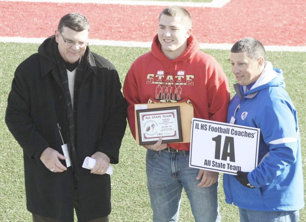 Submitted First-Team All-State Arthur-Lovington/Atwood-Hammond football senior Logan West accepts his plaque at the First-Team All-State Ceremony in DeKalb before the 1A championship game at Huskie Stadium, Friday, November 29. Teammates Jordan Feagin and Tyler Schuring were selected to the All-State Honorable Mention team.