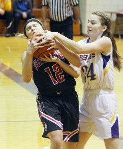 Photo by Keith Stewart Emily Neuhauser battles Monticello's Hannah Smith for the ball Thursday night.