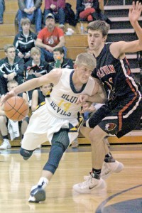 Photo by RR Best Windsor's Alex Allen tries to drive past Sullivan's Ty Molzen during Friday night's matchup.