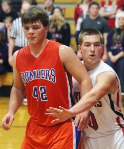 Photo by Keith Stewart Nick Frerichs guards Argenta-Oreana's Keegan McHood Friday night. Even with solid Sullivan defense, McHood led the night with 19 points, though it wouldn't prove enough as the Redskins won out 47-39.