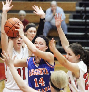 Photo by Keith Stewart Argenta-Oreana's Katlyn Gibson kicks the ball back out after being met by three Sullivan defenders down low. Gibson scored 20 of her team's 34 points on the night, a defensive weakness for Sullivan, who still managed to earn a 34-point margin of victory Friday.