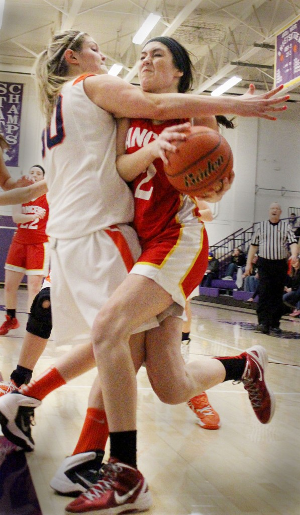 Photo by RR Best ALAH's Emily Seegmiller tries to drive past a Cerro-Gordo/Bement defender Saturday evening.