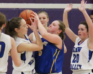 Photo by RR Best Villa Grove/Heritage's Alix Ezzel fights OV's Shelby Dash for the ball Saturday.