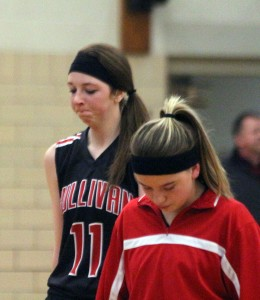 Photo by Keith Stewart Tori Murphy (front) and Brittin Boyer (back) each look down in disappointment after losing to Clinton Thursday 71-65.