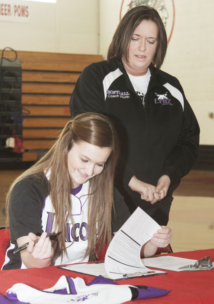 Photo by Keith Stewart Sullivan high school senior and softball standout Taylor Gottfriedt signs with Lincoln College last Friday as Lincoln softball coach  Crystal Wurth watches.