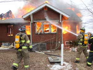 Photo by RR Best Firemen work to extinguish a fire located at a Bethany residence last Thursday afternoon. Wind gusts only fueled the fire more, which took responders nearly three hours to put out. The home has been ruled a total loss.