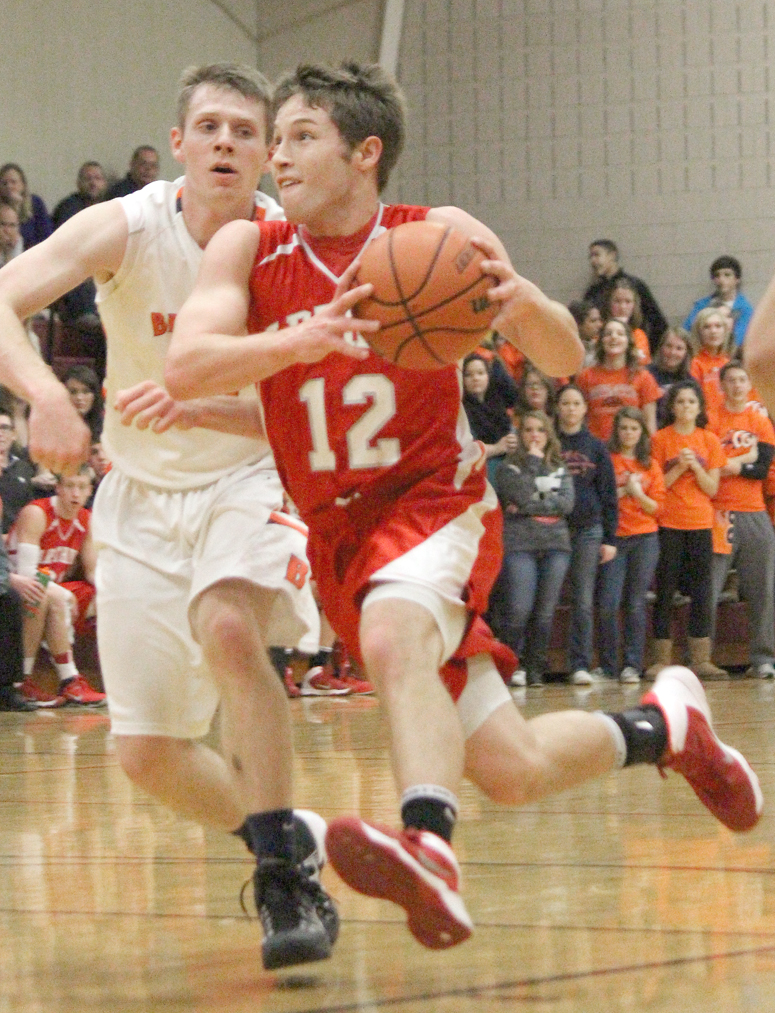 Photo by RR Best AL's Curtis Plank drives to the basket Saturday night. Plank led the team with 16 points.
