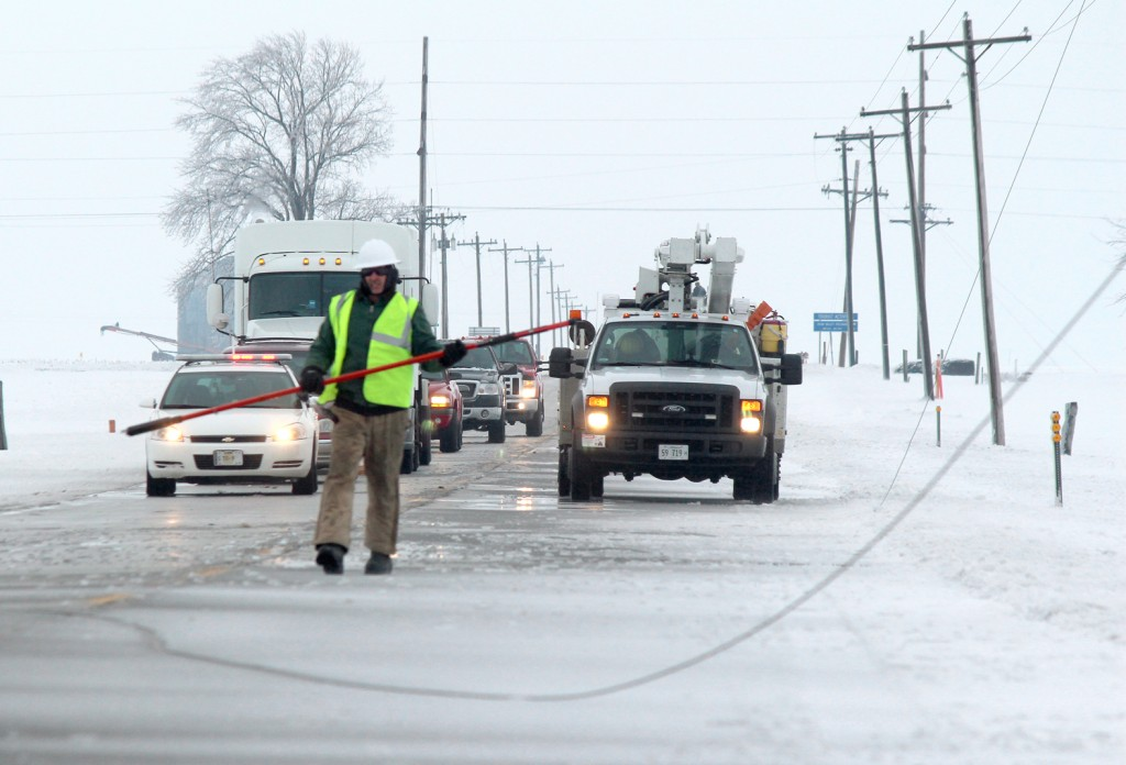 Photo by RR Best Lines Down An employee with Coles-Moultrie is seen in the middle of Route 32 between Sullivan and Lovington Monday afternoon after several power lines were downed due to ice.
