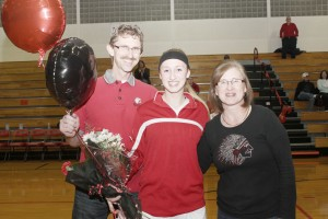 Photo by Keith Stewart Sullivan's lone senior Maggie Plank is seen with her father Jim and mother Lori during senior night Monday night.