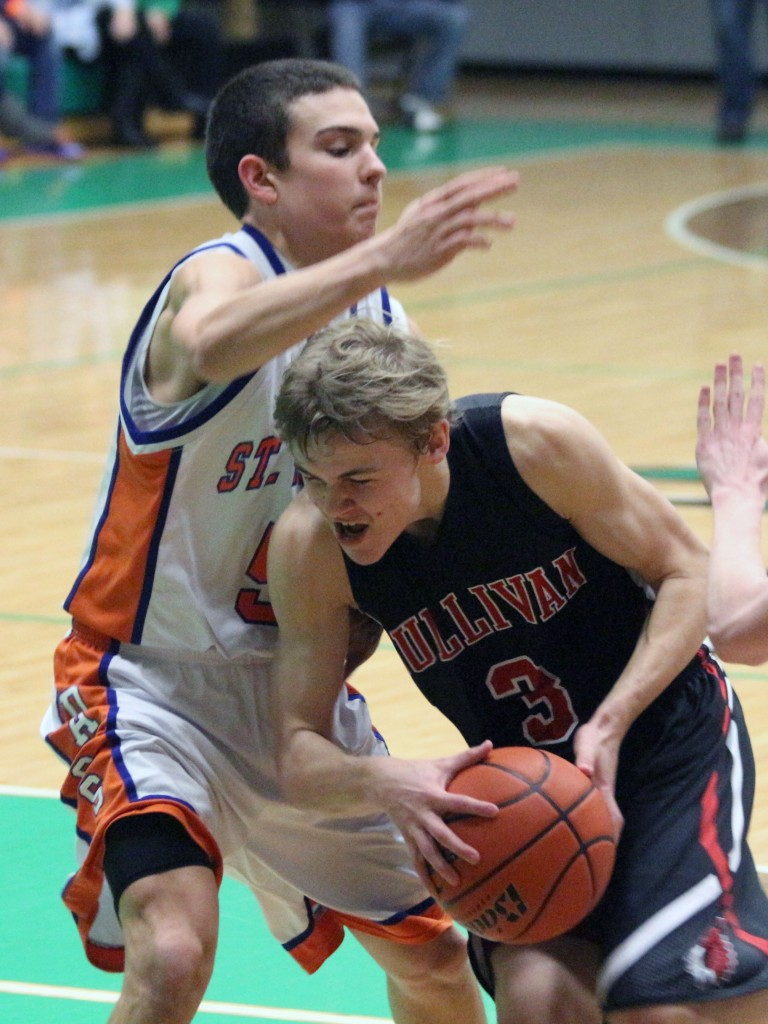 Photo by Keith Stewart Alec Ballinger powers his way through the paint Thursday night.