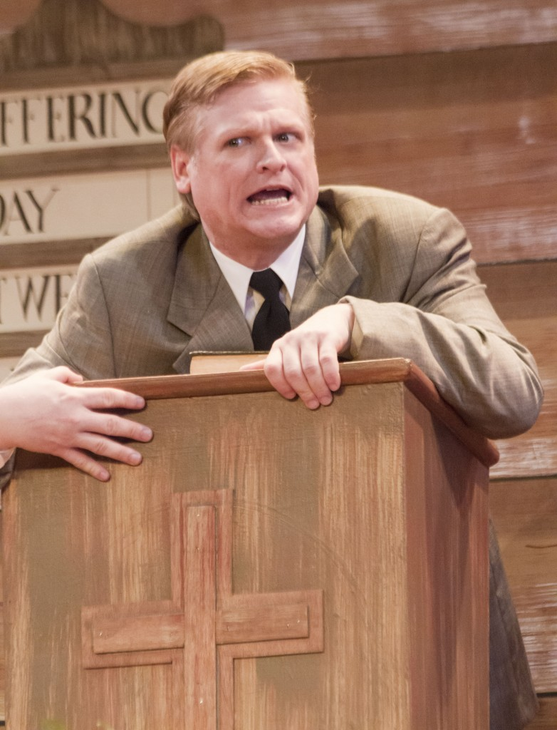 Photo by Keith Stewart Rev. Mervin Oglethrope, played by Gregory Matzker, clenches the pulpit after considering to allow Dennis Sanders a go.