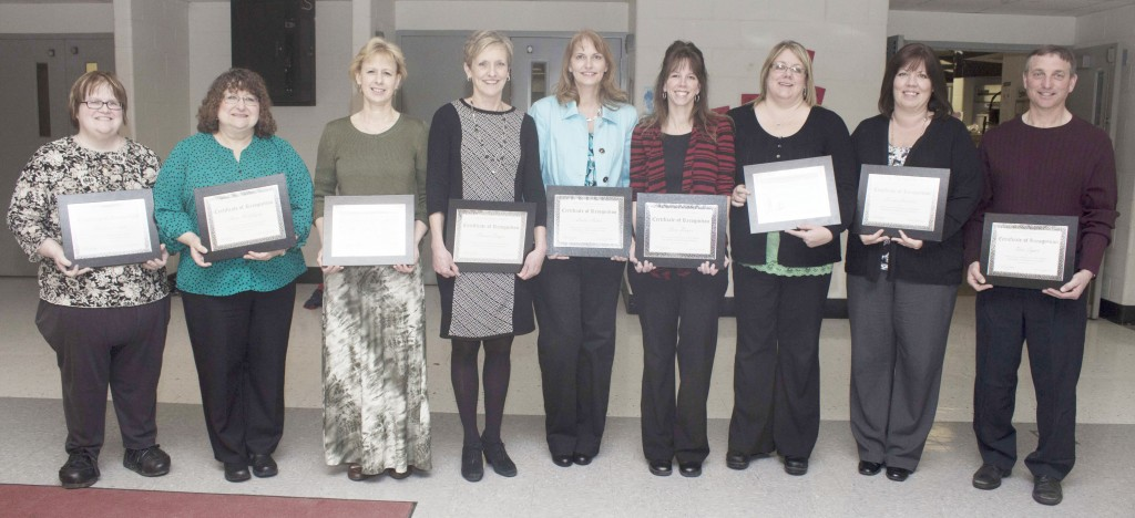 Photo by Keith Stewart Pictured are this year's Sullivan school district employees who were honored at last Thursday's teacher appreciation dinner for their longstanding careers in Sullivan. Pictured from left to right are Becky Lawson, Anne McGhghy, Janet McFarland, Clarice Singer, Leslie Auten, Sara Boyer, Christine Grohler, Karen Harpster, and Don Typer. Not pictured are Chris Sides and Elaine Daniels.