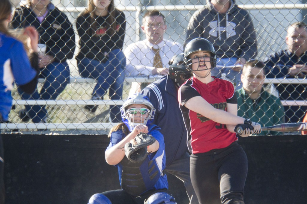 Photo by Keith Stewart Sherelle Coller eyes her deep shot to left field in the fifth inning of Wednesday's game against OV. The senior, along with teammate Katie Wildman, celebrated her birthday with an 8-5 win.