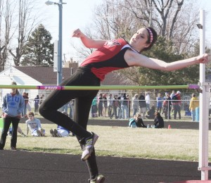 Photo by Keith Stewart SOV's Megan Dash clears the  bar during the high jump last Wednesday at the Arthur Invite. The sophomore cleared five feet to take first place.