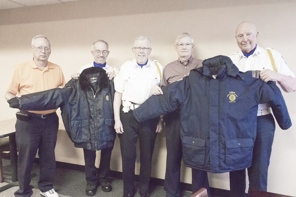 Photo by Keith Stewart Lion's Club Donation Last month the Sullivan Lion's Club donated $500 to the American Legion Post 68 Color/Honor Guard, who in turn was able to purchase several parkas and bomber jackets so that members could be adequately dressed when conducting ceremonies, including military rites. Pictured left to right are: Lynn Elder of the Lion's Club, Mike Keown and Mike Grose (both of the color guard), Lynn Reed, president of the Sullivan Lion's Club, and Bob Sims (also color guard).