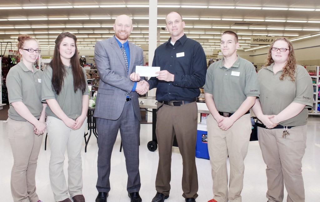 Photo by Keith Stewart Shopko Donates Shoko recently donated a $1,000 check to Sullivan schools. Pictured, from left to right are:  April Reyes (employee), Heather Cody (employee), Ted Walk (SHS assistant principal), J.D. Irons (Shopko manager), Ryan Kalagian (employee), and Kari Fort (employee).