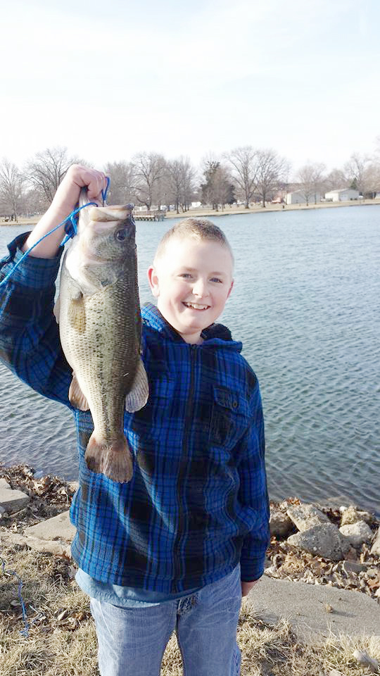 Submitted Nathan Riley is seen with his 20 inch long 5-pound, 7-ounce large-mouth bass, which he caught in Wyman Lake in March.