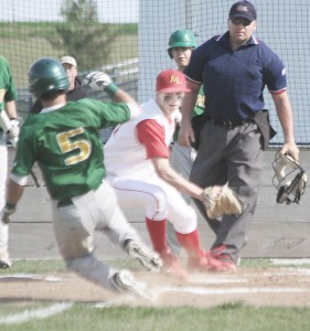Photo by Keith Stewart Tyler Schuring goes to make the tag out at home Monday on St. Thomas More's Sean Sullivan. The ball would come loose, however, with Sullivan scoring, just one of five unearned runs on the day.