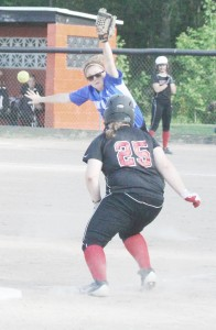 Photo by Keith Stewart Kayla Wheeler watches as a wild throw goes past her during Friday's regional championship game against Central A&M in Ramsey.