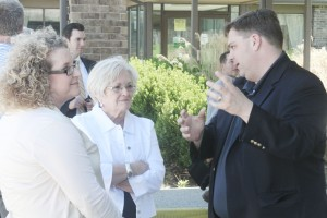Photo by Keith Stewart State Senator Chapin Rose (R-Mahomet) speaks with Sullivan mayor Ann Short (center) and Sullivan Chamber and Economic Development Director Stephanie McMahon (left) just outside the Eagle Creek Resort Friday, April 25. They along with several other local offi cials toured the perimeter of the facilithy after holding a public meeting in Findlay discussing the future of the resort.