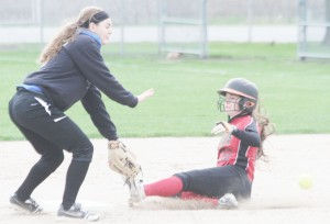 Photo by Keith Stewart OV's Abigail Weybright goes to catch the throwout at second as ALAH's Mycaela Miller slides.