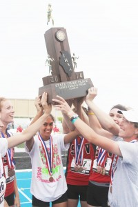 Photo by Keith Stewart Serious Hardware Sullivan-Okaw Valley's girls' track team hoists up their third place team trophy at  Eastern Illinois University's O'Brien Stadium Saturday afternoon after placing in six events, including first in the 400m and 4x200 relay. For the full story see page 12.