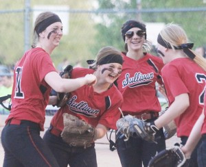 Photo by Keith Stewart Sullivan's Brittin Boyer (left), and Taylor Gottfriedt (left center) celebrate after turning a double play in the ...inning.