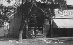 Moultrie Moment of the Week                                                    Pictured here is the Lovington Post Office circa 1909. The post office was located on the north side of State St.  in Lovington. The building located on the left is McDaniels & Bowers Goods. If you have any other information, please contact the Moultrie County Historical Society at 217-728-4085.