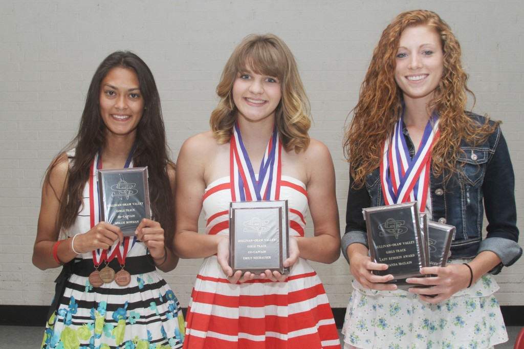 Photo by Keith Stewart SOV Girls' Track Awards The Sullivan-Okaw Valley girls' track team held their awards' banquet on May 29. Pictured, left to right, are: Mollie Bowman, co-captain; Emily Neuhauser, co-captain; and Amanda McClain, co-captain, high-point award, and Lady Redskin award.